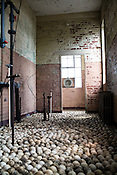 May 8, 2009. Raleigh, NC..Photographs of the Bain Project, a former city water plant that has now been given over to local artists to reuse and redevelop the site.. Rock balls that formerly helped cleanse the water have been arranged in one of the rooms.