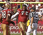 San Francisco 49ers defensive end Chidi Ahanotu (72) complains to referee on Sunday, October 19, 2003, in San Francisco, California. The 49ers defeated the Buccaneers 24-7.