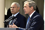 United States President George W. Bush makes an announcement in concerning his Middle East policy in the Rose Garden of the White House in Washington, DC on April 4, 2002 as US Secretary of State Colin Powell looks on.<br /> Credit: Ron Sachs / CNP