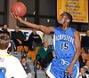 Lykeem Bethea #15 of Hempstead tries to drive to the hoop during the Nassau County varsity boys basketball Class AA quarterfinals against host Massapequa High School on Wednesday, Feb. 17, 2016. Massapequa won by a score of 50-38.