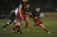 Chris Ashton of Saracens looks for a gap past George Kruis of Saracens during the Premiership Rugby match between Saracens and Leicester Tigers - 02/01/2016 - Allianz Park, London<br /> Mandatory Credit: Rob Munro/Stewart Communications