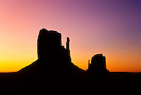 A silhoette of The Mittens table mountains at sunset in Monument Valley National Park and navaho Indian reservation,  Utah, USA