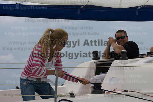 Hungarian celebrity Orsolya Sandor posing for photographers on board the Nautica class ship Blues. 40th Blue Ribbon Regatta race with 570 participating yachts sailing the 160 km course around Lake Balaton near Balatonfured. Hungary. Friday, 18. July 2008. ATTILA VOLGYI