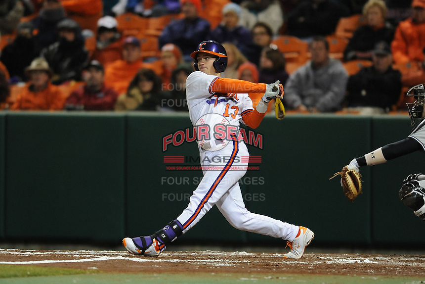 Clemson Tigers third baseman Jay Baum #13 swings at a pitch during a game against the South Carolina Gamecocks at Doug Kingsmore Stadium on March 1, 2013 in Clemson, South Carolina. The Gamecocks won 6-0.(Tony Farlow/Four Seam Images).