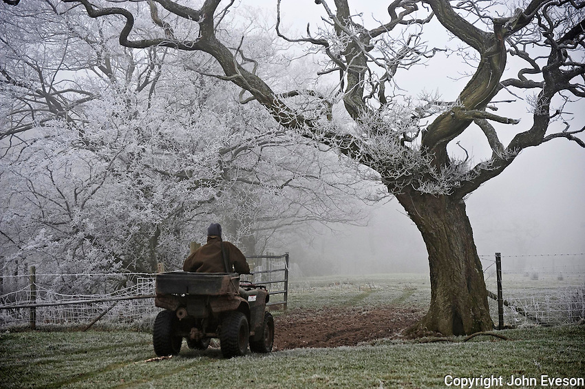 Gamekeeper on an All Terraine Vehicle with frost and fog, Whitewell, Lancashire.