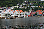 View over water to historic buildings in Vagen harbour area to Torget fish market, city of Bergen, Norway