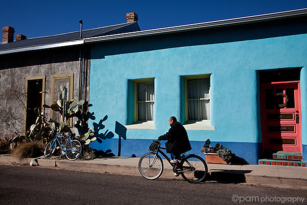 Soutwest home with man riding bicycle