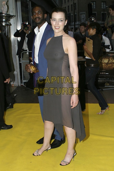 OLIVIA WILLIAMS.UK Premiere of M. Night Shyamalan's The Village at Odeon West End Leicester Square, London W1.August 10th, 2004.full length, black halterneck dress, see through, see thru, nipple.www.capitalpictures.com.sales@capitalpictures.com.© Capital Pictures.