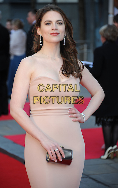 Hayley Atwell.The Olivier Awards 2012, Royal Opera House, Covent Garden, London, England..April 15th, 2012.half length pink strapless dress hand on hip clutch bag silver .CAP/WIZ.© Wizard/Capital Pictures.