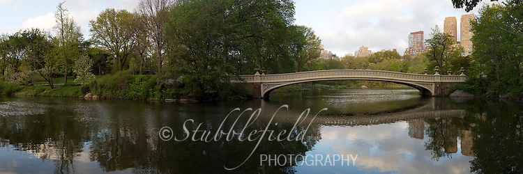 Panorama of Bow Bridge in New York City's Central Park at sunrise in the Spring.