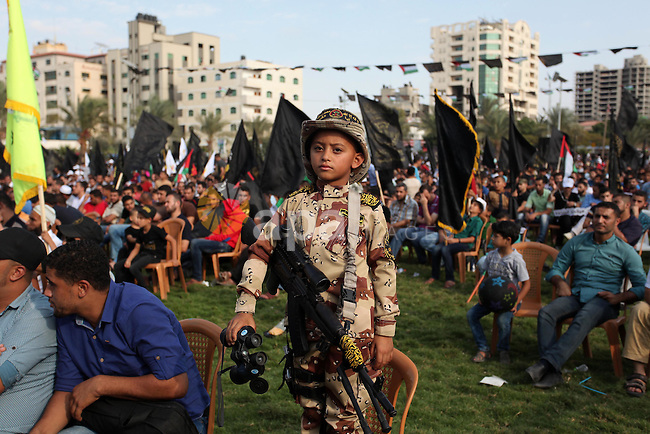 A Palestinian boy attends a rally marking the 29th anniversary of the foundation of the Islamic Jihad movement in Gaza City October 21, 2016. Photo by Ashraf Amra