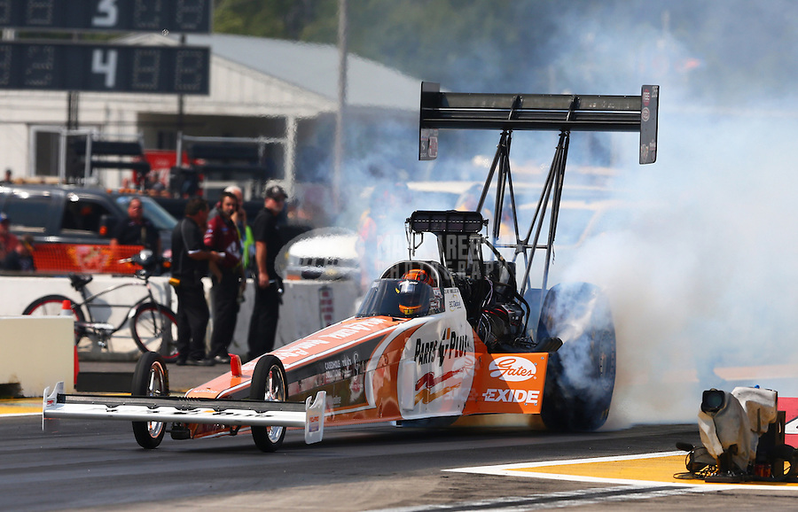 Aug. 18, 2013; Brainerd, MN, USA: NHRA top fuel dragster driver Clay Millican during the Lucas Oil Nationals at Brainerd International Raceway. Mandatory Credit: Mark J. Rebilas-