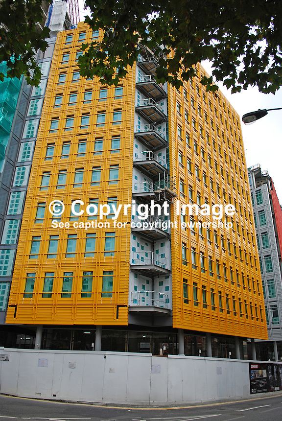 Central Saint Giles development, central London, UK. Architect, Renzo Piano, Italy. Development includes office, appartments, retail units, restaurants, cafes and a public piazza. Most distinctive feature is the multicoloured glazed ceramic cladding that makes the building stand out. 200909223089..Copyright Image from Victor Patterson, 54 Dorchester Park, Belfast, UK, BT9 6RJ..Tel: +44 28 9066 1296.Mob: +44 7802 353836.Voicemail +44 20 8816 7153.Skype: victorpattersonbelfast.Email: victorpatterson@mac.com.Email: victorpatterson@ireland.com (back-up)..IMPORTANT: If you wish to use this image or any other of my images please go to www.victorpatterson.com and click on the Terms & Conditions. Then contact me by email or phone with the reference number(s) of the image(s) concerned.