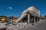 Wrecking crews remove a large portion of Westerville Square Shopping Center to make way for the construction of a new WalMart store in the Columbus suburb. The store will approximately 108,000-square-feet, about half the  size of a traditional WalMart super store..