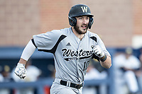Western Michigan Broncos third baseman Jimmy Roche (10) runs to first base against the Michigan Wolverines on March 18, 2019 in the NCAA baseball game at Ray Fisher Stadium in Ann Arbor, Michigan. Michigan defeated Western Michigan 12-5. (Andrew Woolley/Four Seam Images)