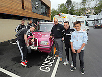 """Pictured L-R: Players Alvaro Vasquez, Jordi Amat, Ashley Williams, new owner Leigh Evans and player Leon Britton with the Suzuki Samurai at the Landore Training Ground. Saturday 10 May 2014<br /> Re: Leigh Evans of Leigh Enterprise Tyres is the new owner of """"the pink Ferrari"""", an old Suzuki Samurai 4x4 car used by Swansea City FC players during the last season."""