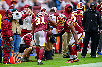 Landover, MD - September 23, 2018: Washington Redskins defensive back Josh Norman (24) celebrates cornerback Fabian Moreau (31) strip fumble on the sideline during game between the Green Bay Packers and the Washington Redskins at FedEx Field in Landover, MD. The Redskins get the win 31-17 over the visiting Packers. (Photo by Phillip Peters/Media Images International)