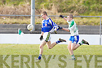 Ballydonoghue's Darragh O'Shea pulls back Templenoe's Gavin Crowley in the 1st round of the Novice Championship at Ballydonoghue on Saturday.