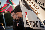 Two boys with banners asking the repatriation of basque political prisoners get ready to the march. Caceres (Spain). February 20, 2016. Some friends and relatives of Basque political prisoners take part on a march to Caceres penitentiary center, within the campaign of 40 marches to 40 prisons where Basque prisoners are imprisoned. These marches are to denounce the dispersal policy those prisoners suffer since more than 25 years. (Gari Garaialde / Bostok Photo)