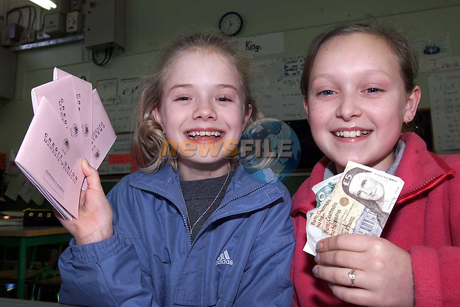 Students from Mount Hanover school with there savings and Credit Union Books.Pic Fran Caffrey Newsfile