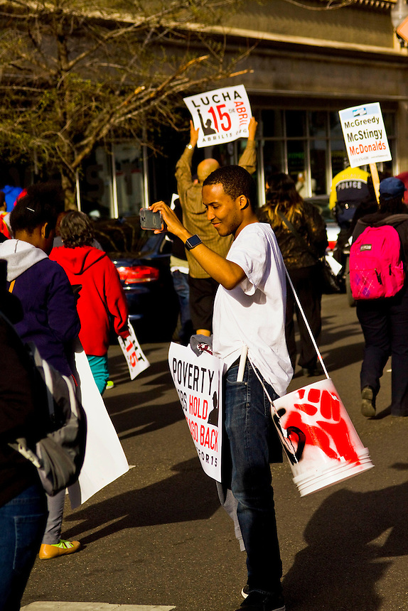 Fast food, retail, cab drivers, caregivers, and other workers rallied to demand a pay increase to $15 an hour.