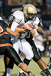 Beverly Hills, CA 09/23/11 - Tommy Webster (Peninsula #49) in action during the Peninsula-Beverly Hills Varsity football game.