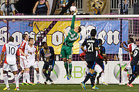 Toronto FC goalkeeper Joe Bendik (12) punches a ball away. The Philadelphia Union defeated Toronto FC 1-0 during a Major League Soccer (MLS) match at PPL Park in Chester, PA, on October 5, 2013.