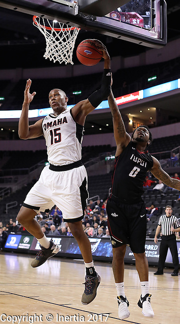 SIOUX FALLS, SD: MARCH 6: Tre'Shawn Thurman #15 of Omaha grabs a rebound in front of Darell Combs #0 of IUPUI during the Summit League Basketball Championship on March 6, 2017 at the Denny Sanford Premier Center in Sioux Falls, SD. (Photo by Dick Carlson/Inertia)
