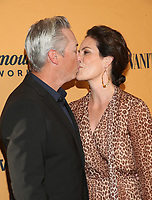 LOS ANGELES, CA - JUNE 11: Wade Allen, Annabeth Gish, at the premiere of Yellowstone at Paramount Studios in Los Angeles, California on June 11, 2018. <br /> CAP/MPI/FS<br /> &copy;FS/MPI/Capital Pictures