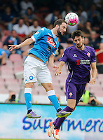 Napoli's Gonzalo Higuain head the ball during the Italian Serie A soccer match between SSC Napoli and AC Fiorentina  at San Paolo stadium in Naples,October 18, 2015