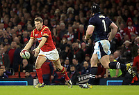 Dan Biggar of Wales (L) prepares to kick the ball forward over Alasdair Dickinson of Scotland (R) during the RBS 6 Nations Championship rugby game between Wales and Scotland at the Principality Stadium, Cardiff, Wales, UK Saturday 13 February 2016