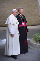 Pope Francis  Monsignor Georg Gaenswein  during a meeting Spain's King Juan Carlos  and Queen Sofia  at the end of their private audience at the Vatican. on April 28, 2014
