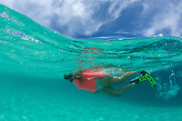 Snorkeler in the clear turquoise water surrounding Buck Island National Monument<br /> St. Croix<br /> US Virgin Islands