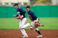 10 october 2009: Florian Peyrichou of Savigny and Yann Dal Zotto run back to the dugout during game 4 of the 2009 French Elite Finals won 7-2 by Huskies of Rouen over Lions of Savigny, at Stade Jean Moulin stadium in Savigny sur Orge, near Paris, France. Rouen wins the 2009 France championship, his sixth title.