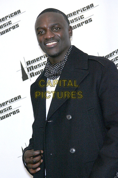 "AKON.Winners Favorite Album for ""All the Right Reasons"".34th Annual American Music Awards - Press Room held at the Shrine Auditorium, Los Angeles, California, USA..November 21st, 2006.half length black jacket.CAP/ADM/ZL.©Zach Lipp/AdMedia/Capital Pictures"