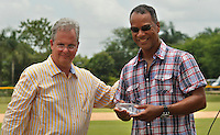 Moises Alou (R) is congratulated by Jorge Perez-Diaz, head of Latin American Oversight for Major League Baseball at the end of the tournament in Boca Chica August 8, 2011 the tournament called Torneo Supremo which aims to maximize the ability of Major League Baseball organizations to scout in the Dominican Republic. El Torneo Supremo will consist of four teams playing one game per week in addition to a mid-tournament All-Star event, as well as championship and consolation games. Tournament participants will also be provided in-classroom education opportunities. April 2011. ViewPress/ ZZ
