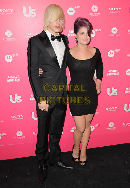 LUKE WORRALL & KELLY OSBOURNE.The Annual US Weekly Hot Hollywood Style Party at Drai's in Hollywood, California, USA..April 22nd, 2010.full length dress black tuxedo couple hand on hip purple tinted dyed hair open toe shoes .CAP/RKE/DVS.©DVS/RockinExposures/Capital Pictures.