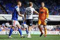 George Byers of Swansea City (C) protests to referee Darren England in front of Dean Gerken of Ipswich Town (R) during the Sky Bet Championship match between Ipswich Town an Swansea City at Portman Road Stadium, Ipswich, England, UK. Monday 22 April 2019