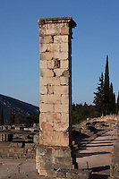 DELPHI, GREECE - APRIL 11 : A general view of the pedestal of the statue of King Prusias II of Bithynia with the Temple of Apollo in the background at sunrise, on April 11, 2007 in the Sanctuary of Apollo, Delphi, Greece. The pedestal dates 2nd century BC and was holding an equestrian statue of King Prusias II of Bithynia. The ruins of the Temple of Apollo belong to the 4th century BC, the third temple built on the site and completed in 330BC. (Photo by Manuel Cohen)