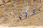 School girls descend steps of ruins at Persepolis, ancient capital of the Persian Empire, in Iran.