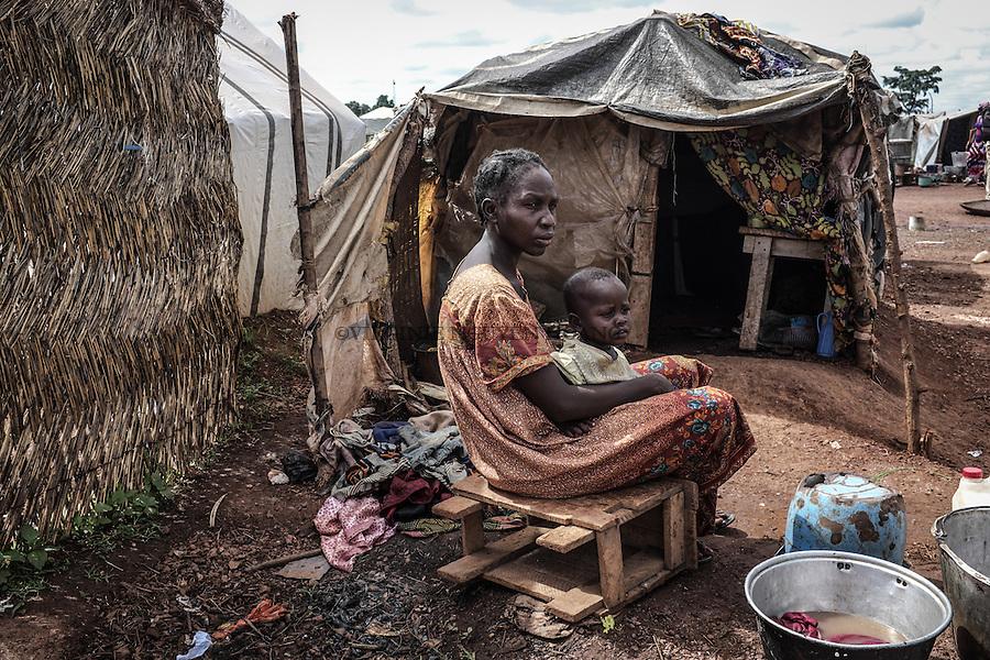 CAR, Bangui: Baovall&eacute;e has three children but lost her husband. She's from Bosangoa and has been living in the Mpoko camp since December 2013. Behind her, the small tent where she's living with her children.  17th April 2016.<br /> RCA, Bangui : Baovall&eacute;e a trois enfants, mais a perdu son mari . Elle est de Bosangoa et vit dans le camp Mpoko depuis D&eacute;cembre 2013. Derri&egrave;re elle, la petite tente o&ugrave; elle vit avec ses enfants . 17 avril 2016.