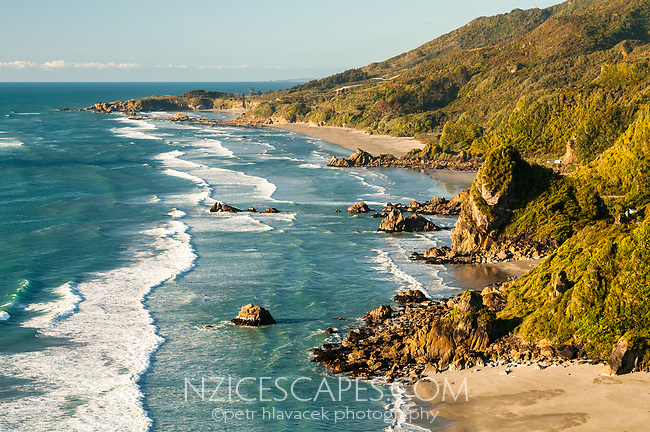 Warm afternoon light over scenic coastline near Punakaiki, Paparoa National Park, Buller Region, West Coast, New Zealand, NZ