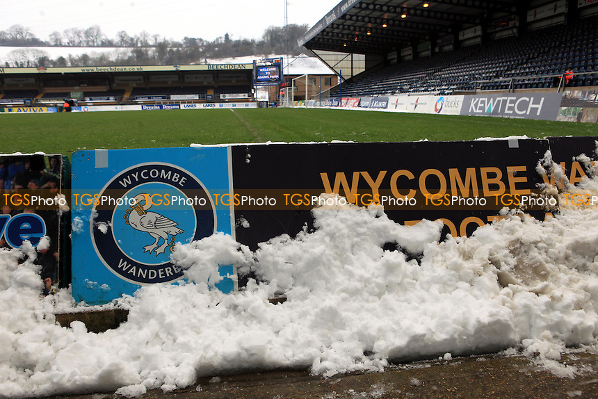 Game on at Adams Park as snow covers the edge of the pitch - Wycombe Wanderers vs Dagenham & Redbridge - NPower League Two Football at Adams Park, High Wycombe - 19/01/13 - MANDATORY CREDIT: Paul Dennis/TGSPHOTO - Self billing applies where appropriate - 0845 094 6026 - contact@tgsphoto.co.uk - NO UNPAID USE.