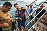 GALAPAGOS ISLANDS, ECUADOR, local fishermen sell fish to the M/C Ocean Spray