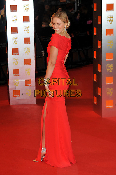 KAROLINA KURKOVA .The Orange British Academy Film Awards 2009, Royal Opera House, Covent Garden, London, England, February 8th 2009..BAFTAS arrivals full length red dress looking back over shoulder rear behind .CAP/PL.©Phil Loftus/Capital Pictures