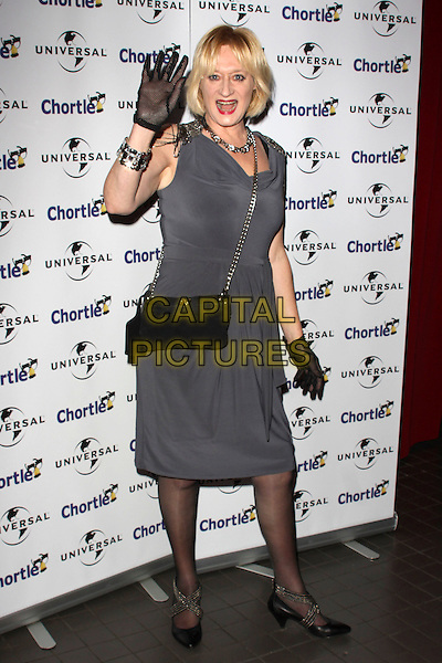 HATTIE HAYRIDGE.Chortle Comedy Awards at Floridita, London, England, UK, .February 7th, 2011..full length grey gray silver grey chains dress hand gloves waving bag black .CAP/AH.©Adam Houghton/Capital Pictures.