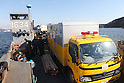 OSHIMA, Japan - Japanese utility repair personnel and vehicles aboard a U.S. Navy landing craft head for the island of Oshima, March 27. The 31st Marine Expeditionary Unit and Amphibious Squadron 11 picked up the vehicles from the port here and delivered food, water, comfort items and the vehicles to residents on the isolated island. The island of Oshima has been cut off from the mainland since the earthquake and tsunami March 11. The operation demonstrated the expeditionary capabilities in ship-to-shore amphibious operations. Marines and Sailors of the 31st MEU are conducting humanitarian aid and disaster relief missions in northeast Japan assisting the Japanese Self Defense Forces in their ongoing operations. (Photo by USMC/AFLO) [0006]
