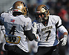 Jason Corso #7, right, and Jake Castellano #4 of Wantagh celebrate after a Roosevelt turnover on downs in the final seconds of the fourth quarter secures a 25-20 win for the Warriors in the Nassau County Conference III varsity football semifinals at Hofstra University on Saturday, Nov. 11, 2017.