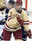 Stevie Moses (UNH - 22), Tommy Cross (BC - 4) - The Boston College Eagles defeated the visiting University of New Hampshire Wildcats 4-3 on Friday, January 27, 2012, in the first game of a back-to-back home and home at Kelley Rink/Conte Forum in Chestnut Hill, Massachusetts.