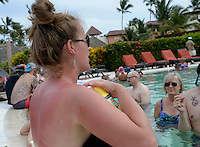 Allison hopes to turn her sunburn into the perfect tan before the wedding on Wednesday, as her mother, Kim, watches from the pool